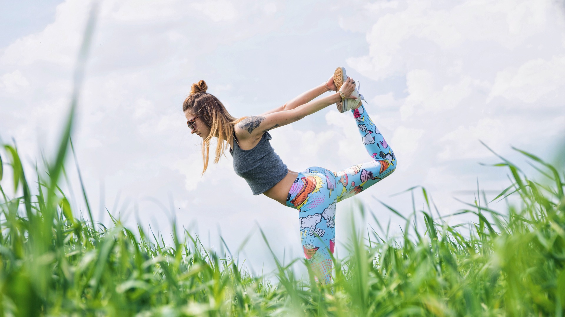 Young woman does yoga outside