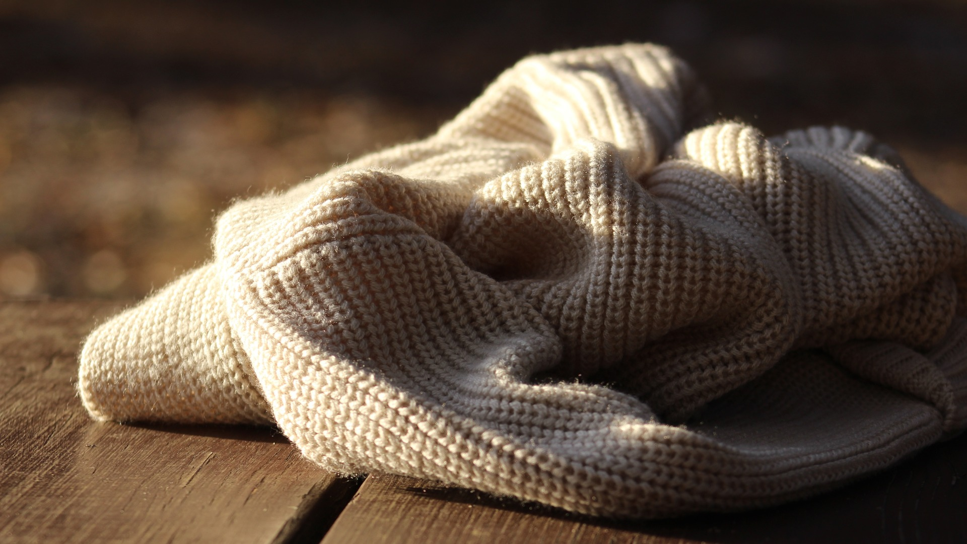 Wool scarf or sweater draped on surface
